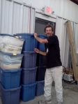 IRC Guest Volunteer Earl helps bring in donations from the community